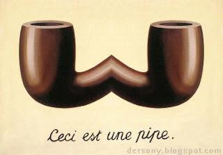 La imagen muestra la cazoleta de la pipa, espejada formando una pseudopipa inusable, bajo la que hay escrito en francés: Esto es una pipa.
