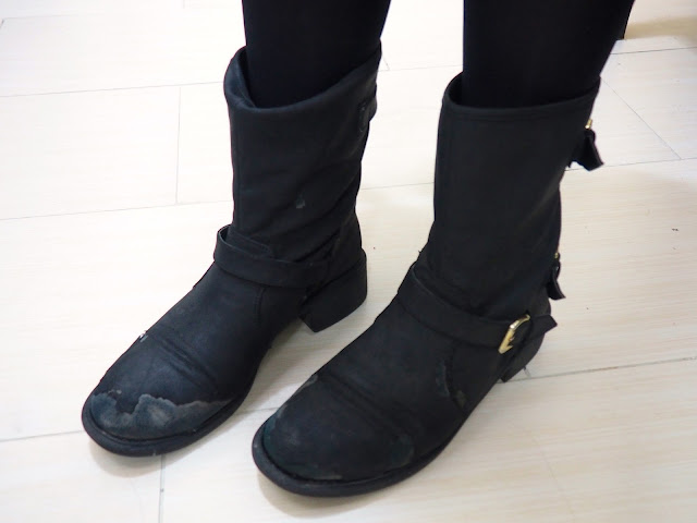 Work in Winter - outfit shoe details of worn out chunky black biker boots, with strap and buckle detailing