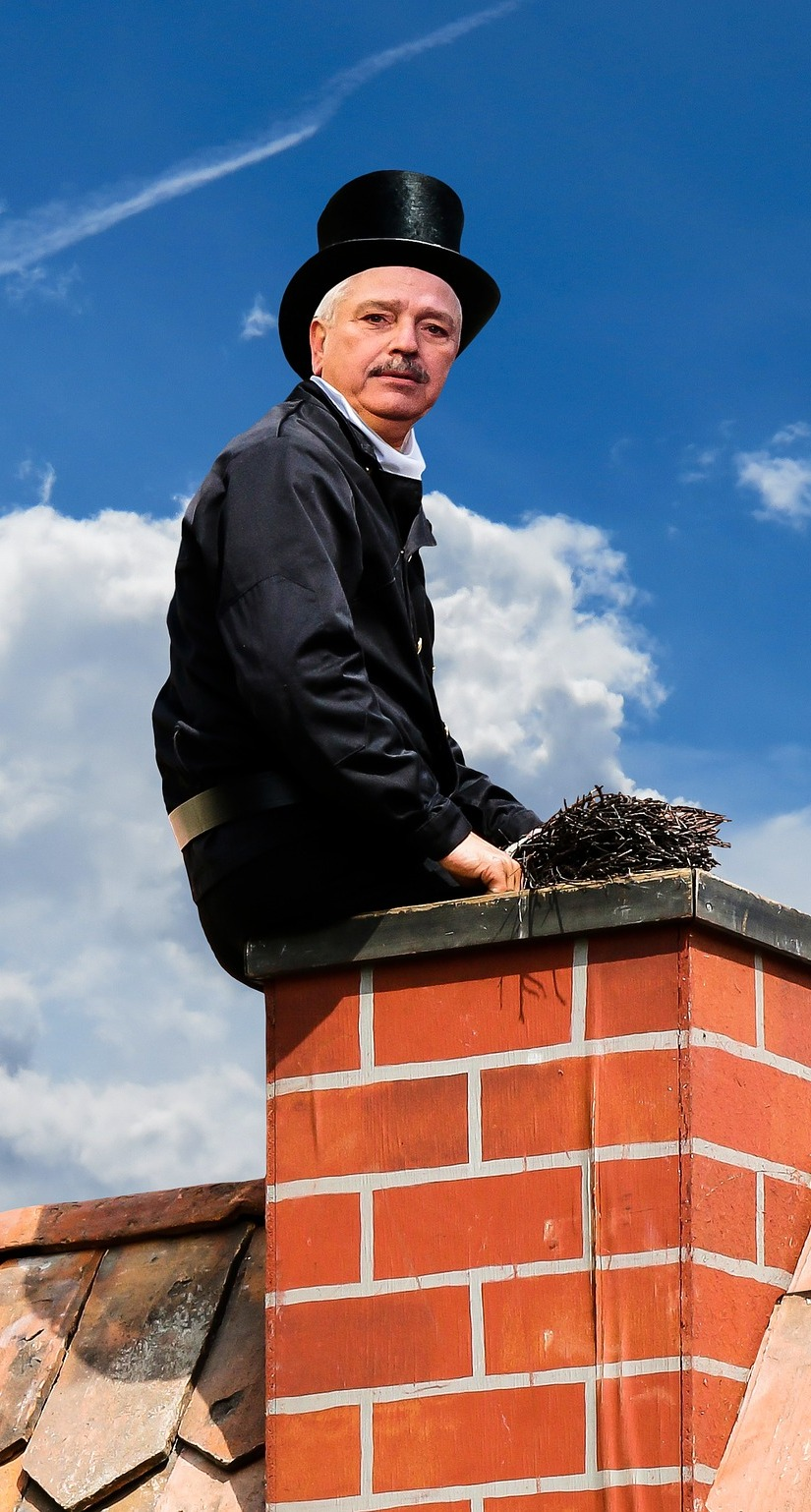 A man on a chimney.