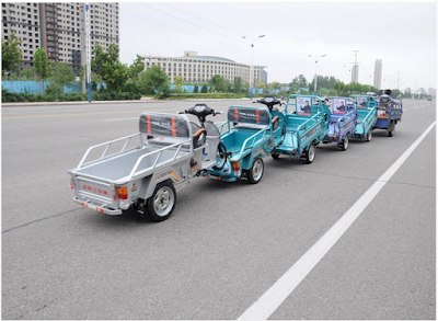 See How An Inventive Chinese Man Transforms 6 Tricycles Into A Mini-Train