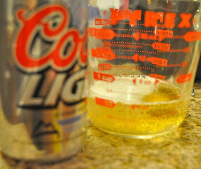 beer biscuits beet in a liquid measuring cup
