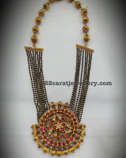 Black Beads Set with Kundan Locket
