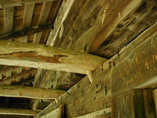 Detail view of the wood peg system used to hold the ceiling joists to the outside wall.