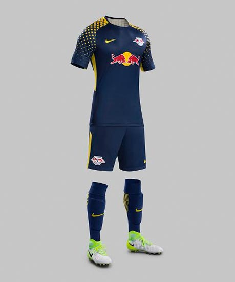 The Leipzig 2017-2018 away shirt is navy blue with gold trim on the  sleeves d405be678