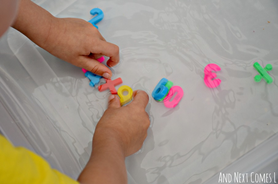 Creating math sentences in a water sensory bin from And Next Comes L