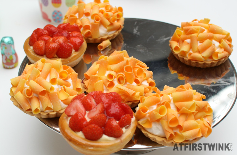 HEMA tarts with strawberries and orange chocolate curls