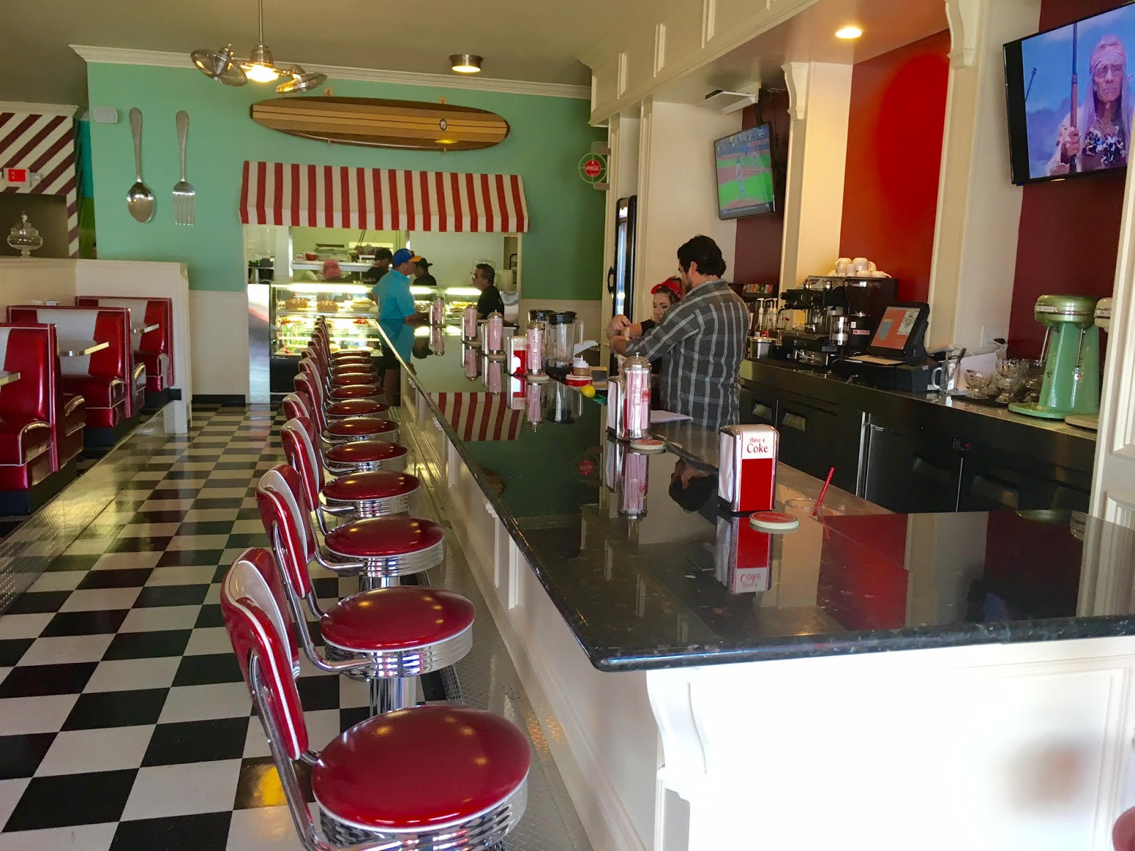 In Time With It S 50s Era Diner Decor That Includes A Black And White Tiled Floor Dessert Display Red Vinyl Booths Celebrity Photos