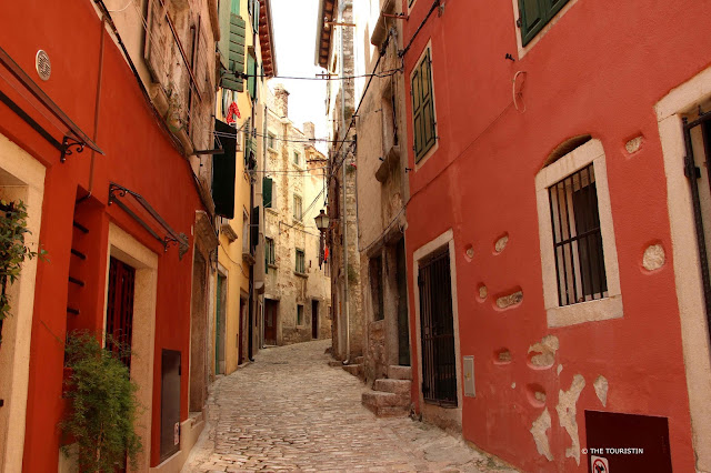 Rovinj, Croatia, Europe, old town. Colourful facades, Umbrellas, washing lines, cafe, cobbled streets.
