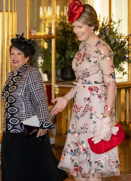 Queen Mathilde wore Natan Couture floral dress, Maison Natan dress, and Aramani blue one shoulder silk dress