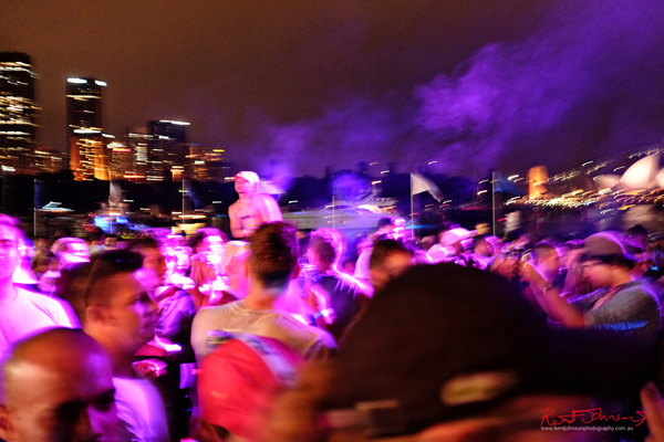 Changing colours wash across the dance crowd by the harbours edge. Harbour Life Music Festival Sydney 2016. Photographed by Kent Johnson for Street Fashion Sydney.