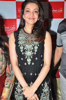 Kajal Aggarwal in lovely Black Sleeveless Anarlaki Dress in Hyderabad at Launch of Bahar Cafe at Madinaguda 047.JPG