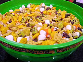 snack mix in a large green bowl