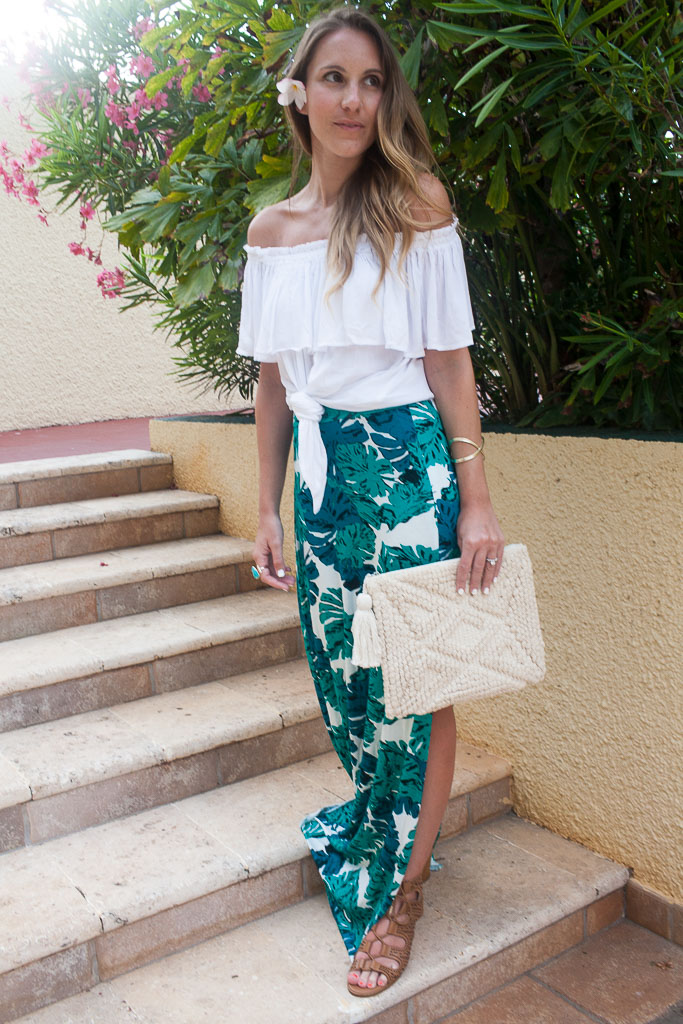 A palm print skirt and off the shoulder top.