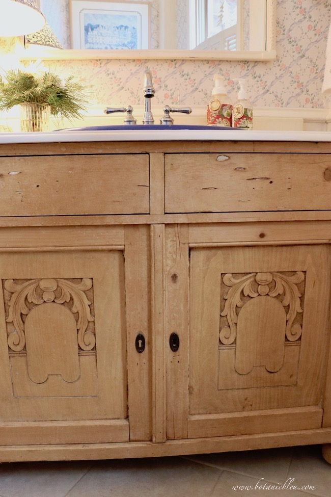 Budget wise cultured marble countertop with ogee edges in a vintage pine washstand