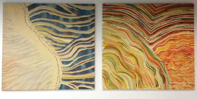 Two large dot paintings symbolising the sand dunes in both the coastal and desert areas.