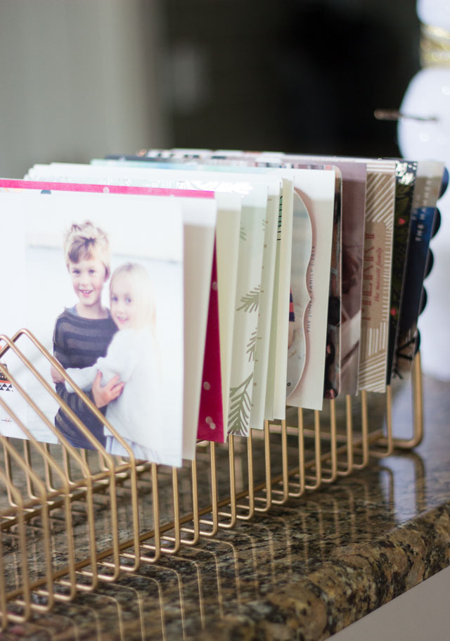 Turn an old CD rack into a modern holiday card display! || http://www.designimprovised.com