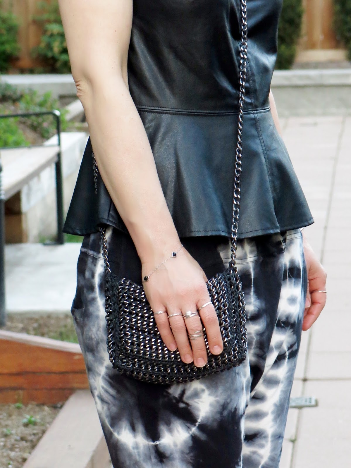 faux-leather peplum top, chain-mail cross-body bag