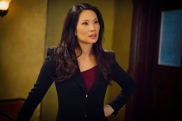 Joan Watson wearing black blazer dress CBS Elementary Season 3 Episode 13 Hemlock