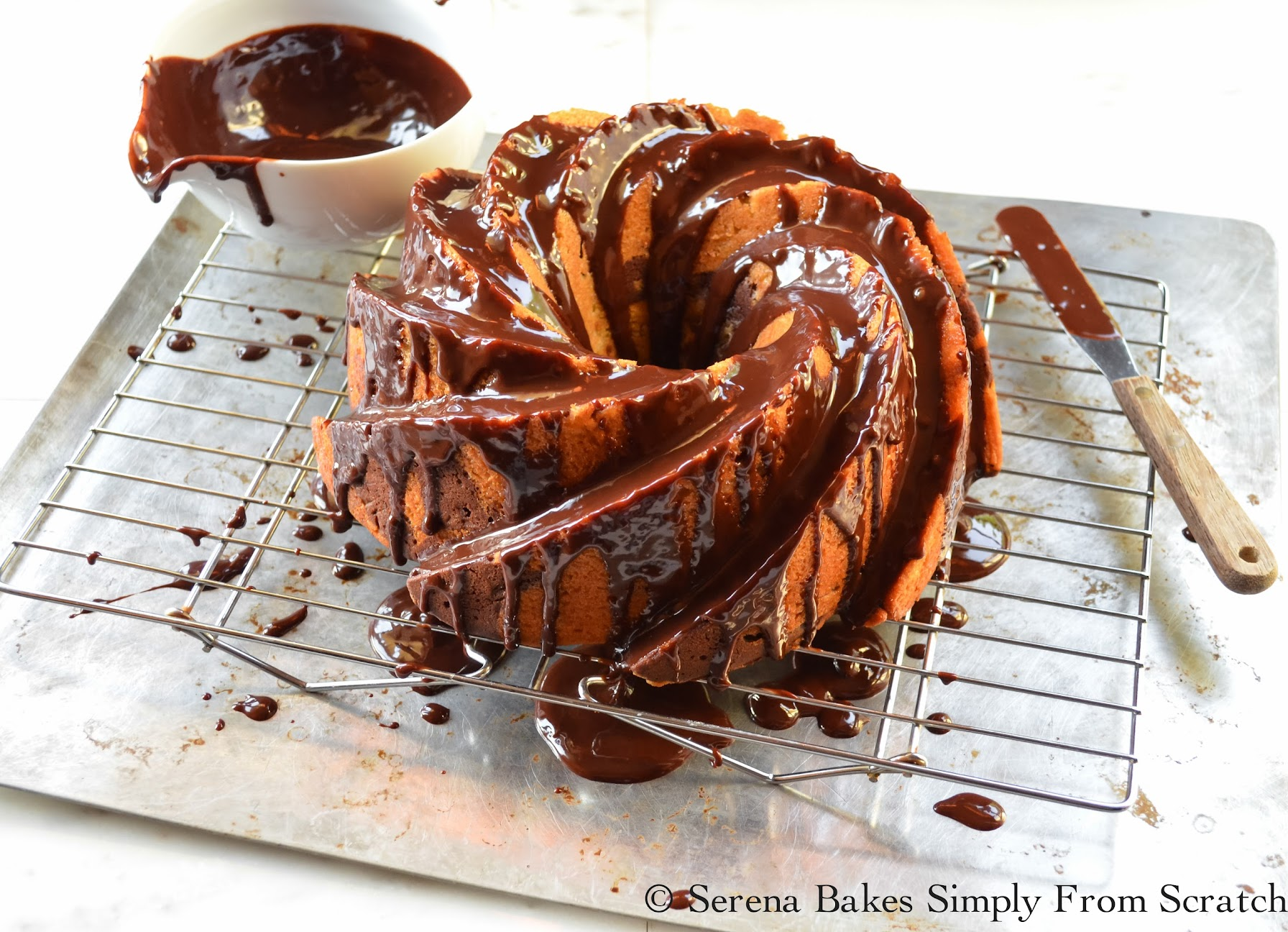 Buttermilk Marble Bundt Cake cover with glossy chocolate glaze.