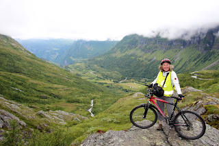 Janie Robinson biking Geirangerfjord, Norway. Photograph by Brian Quinn, Travel Writer