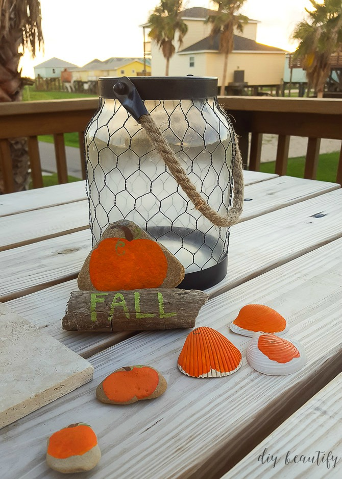 pumpkins painted onto rocks and shells