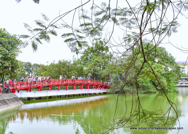 the picturesque Huc bridge in Hoan Kiem Lake