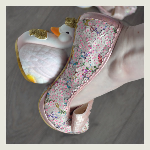 wearing irregular choice pink savan swan heel detail