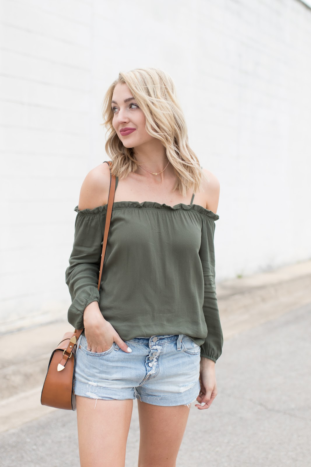 Off-the-shoulder top with jean shorts
