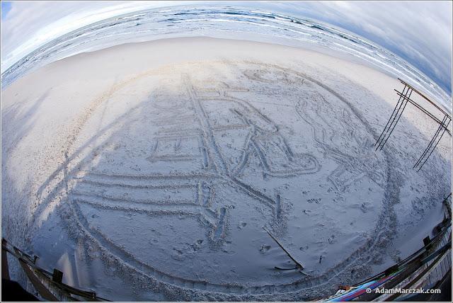 logo recona w piasku