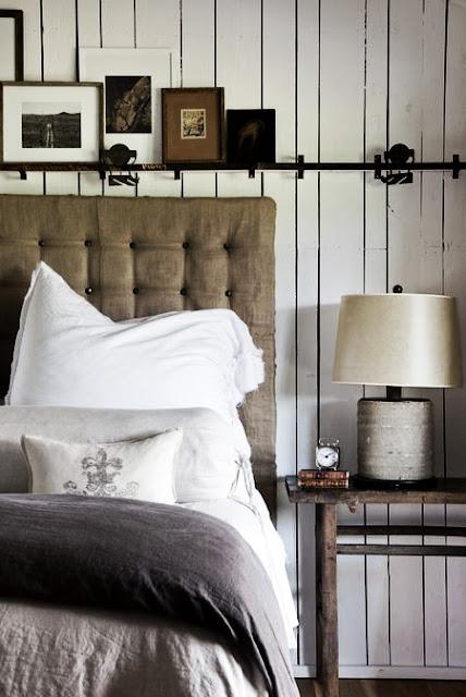 Modern farmhouse bedroom with industrial rail over bed and rustic decor. #farmhouse #bedroom #industrialfarmhouse #rusticdecor #interiordesign