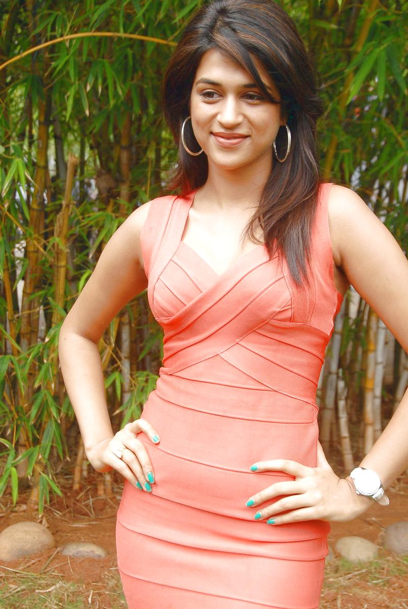 gorgeous and splendid Shraddha das in red cocktail dress latest hot hq stills