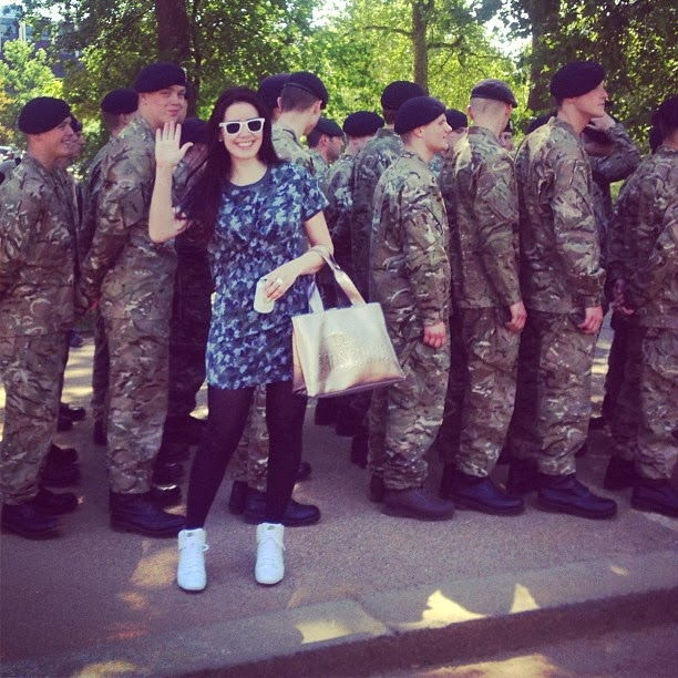 Fashion blogger Emma Louise Layla Karl Lagerfeld camouflage dress with the army boys in Hyde Park, London