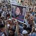 Who is Malik Mumtaz Hussain Qadri ?