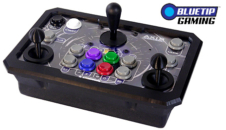 An arcade stick with two analogue sticks and a large digital stick for d-pad use.