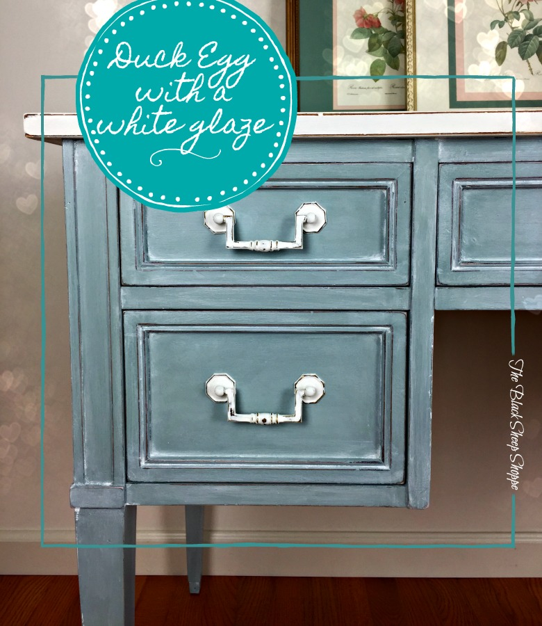 Duck egg blue chalk paint with a winter white glaze.