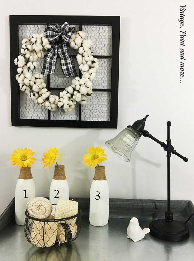 Vintage, Paint and more... cotton wreath made from a cotton garland hanging on a chicken wire picture frame, egg basket with crochet threads, diy painted and stenciled milk bottles with daisies, vintage lamp,