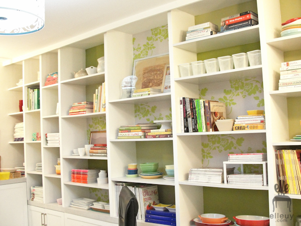 bookshelf, built-in, fun shelves, wallpapered shelves, green shelves, shelf styling, styled shelves