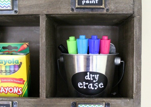 Organized art station for kid's art and craft supplies: Use tin buckets to store materials