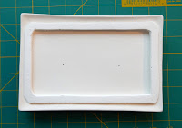 Fiber paper rim placed on mold