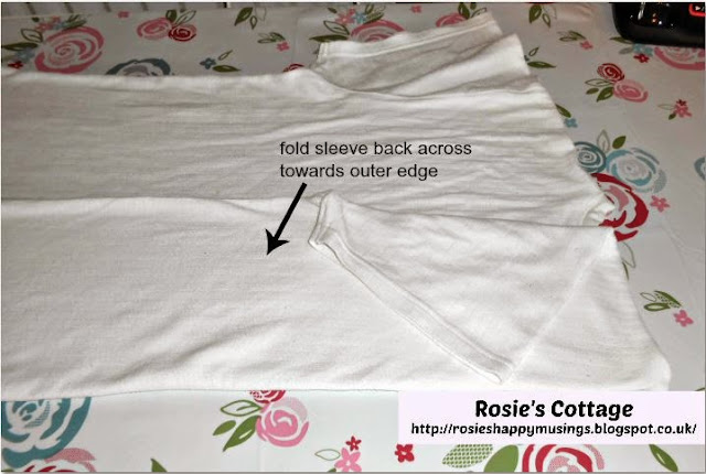 How to fold t shirts without a folding board - step three fold the sleeve back across towards outer edge