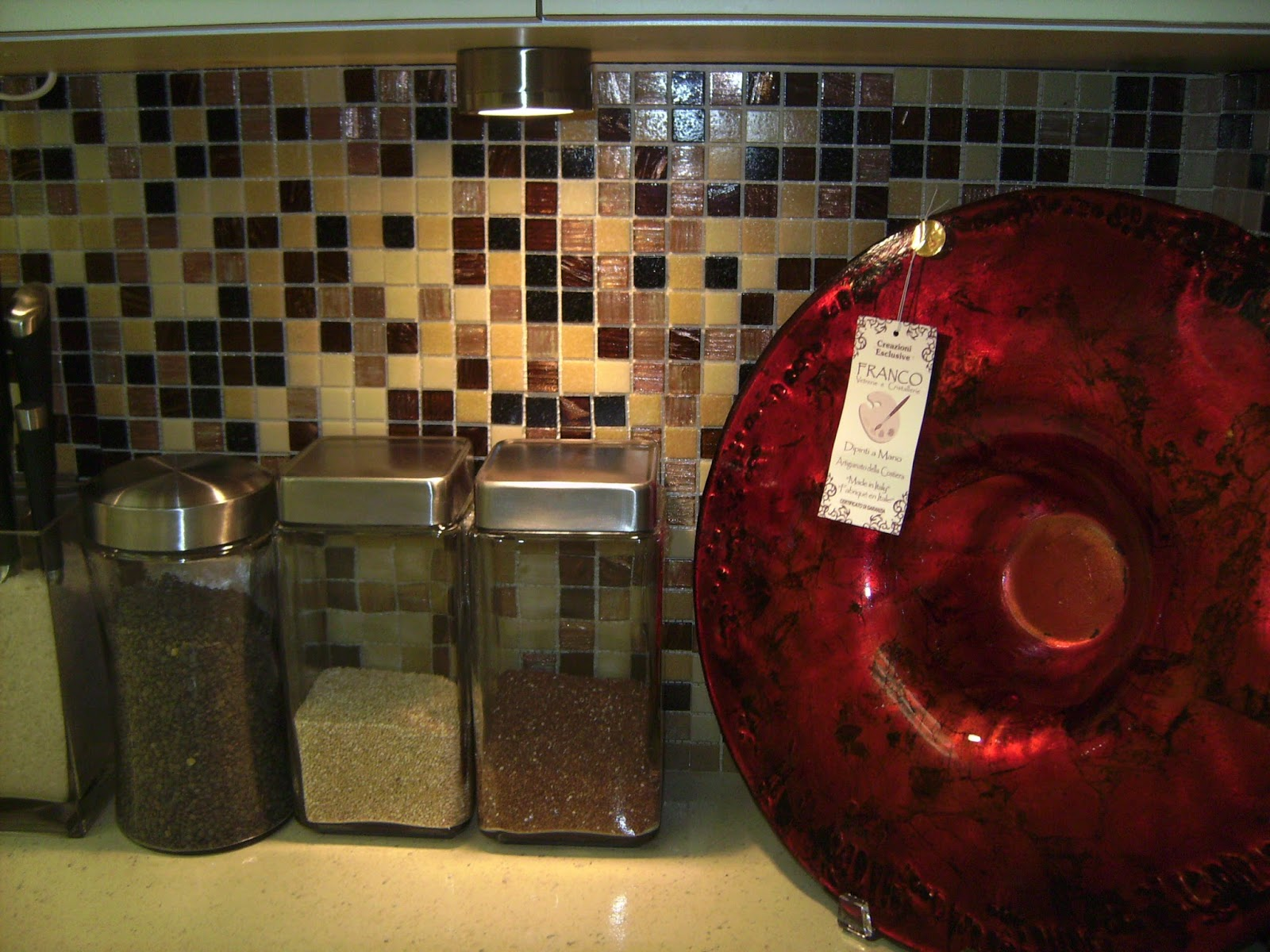 How to Remodel and Decorate a Small Kitchen, adding under the cabinet lighting, glass tile back splash