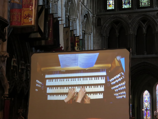 Screen showing organists playing at St. Patrick's Cathedral in Dublin