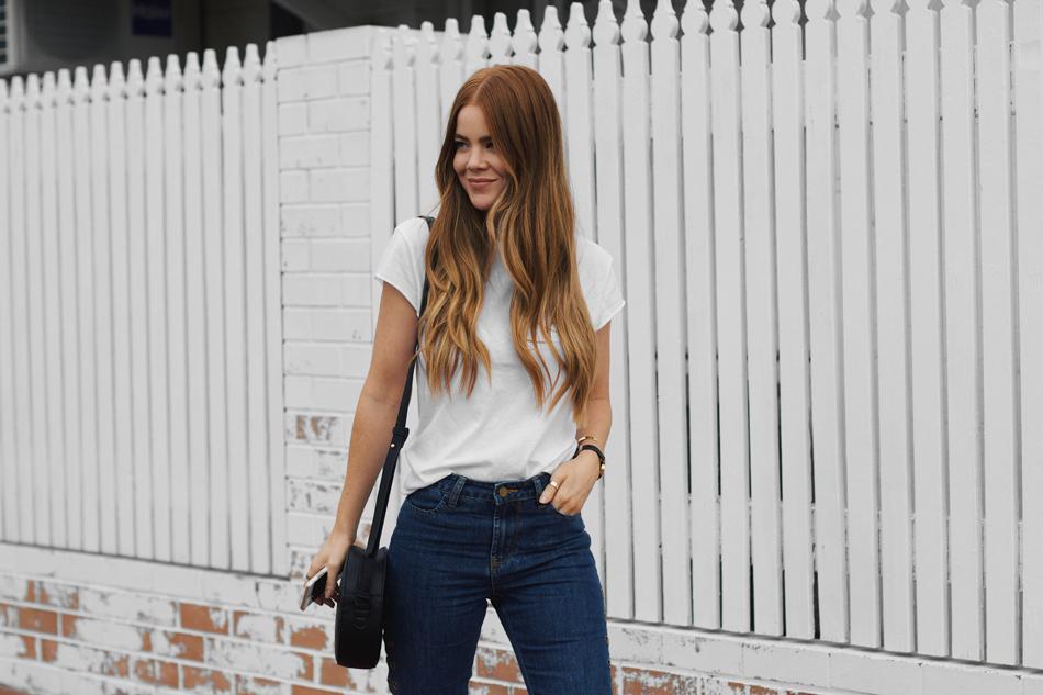 NA-KD t-shirt, relaxed blue denim jeans, eyelet trend, raw hemline