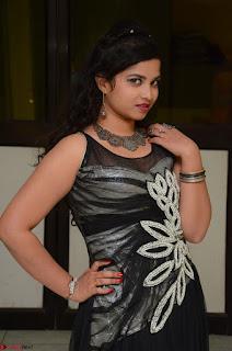 Shrisha Dasari in Sleeveless Short Black Dress At Follow Follow U Audio Launch 001.JPG
