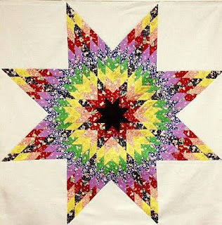 http://www.craftsy.com/pattern/quilting/home-decor/roy-g-biv-lone-star/32990