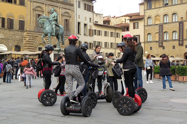 Group of tourists on Segways, Piazza della Signoria, Florence