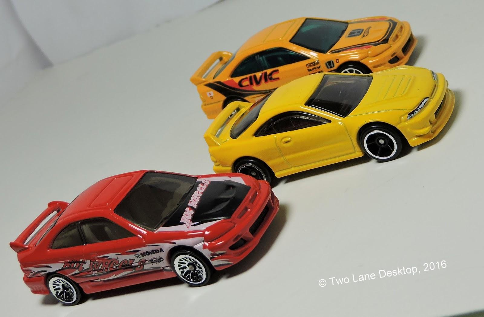 Two lane desktop hot wheels 2001 acura integra gs r and 2000 honda civic si and johnny lightning acura integra type r