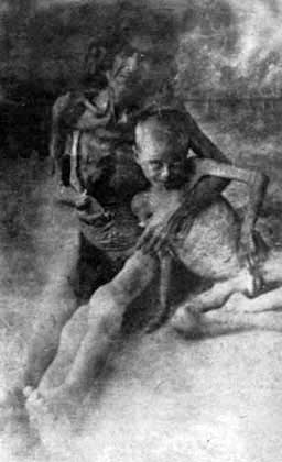 The Recognition of the genocides as the beginning of justice against the crimes against humanity and barbarity - Starved Armenian woman with her son in Syrian desert, 1916
