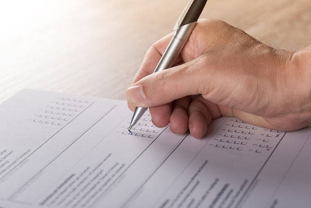 A man filling a survey form