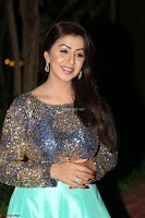 Nikki Galrani in Green Skirt  Top at Marakathamani music launch ~  Exclusive (84).JPG